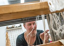 Student learning the weaving process at the ASU school of Art