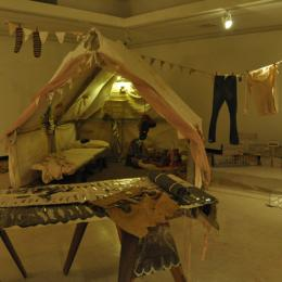 Feather Rolls/ Canvas Tent. 2011. Mixed media. Dimensions variable.