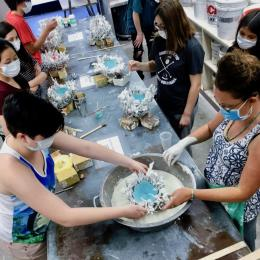 Students and teacher working on projects in summer camp, Casting the Natural World in Clay