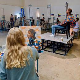 Students working from a model in the summer camp, Painting Portraits