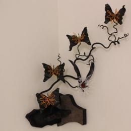 """Flutter Vine & Suckle Bunny"" 2012. Iron, Steel, Rubber, & powder coat. 2' x 2' x 1'"