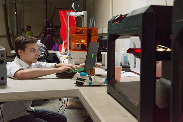 Intermedia student using 3d printer